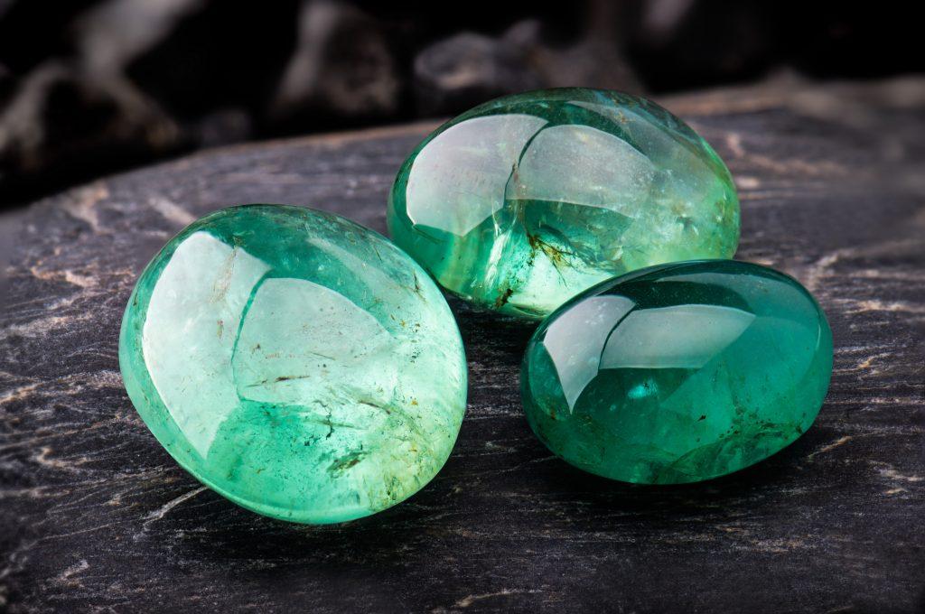 three emerald gemstones
