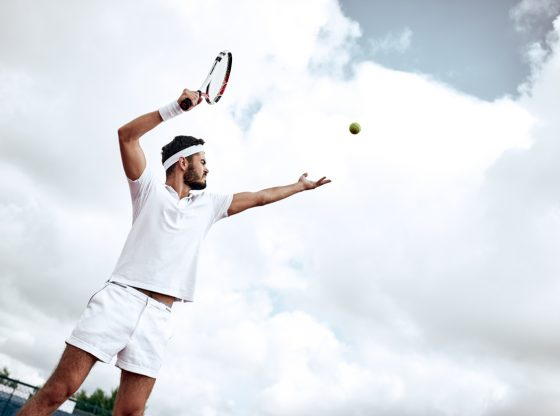 Man playing a game of tennis
