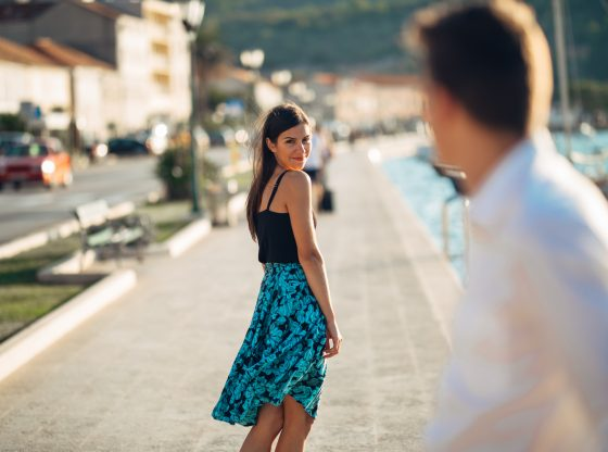 woman smiling at man on the street