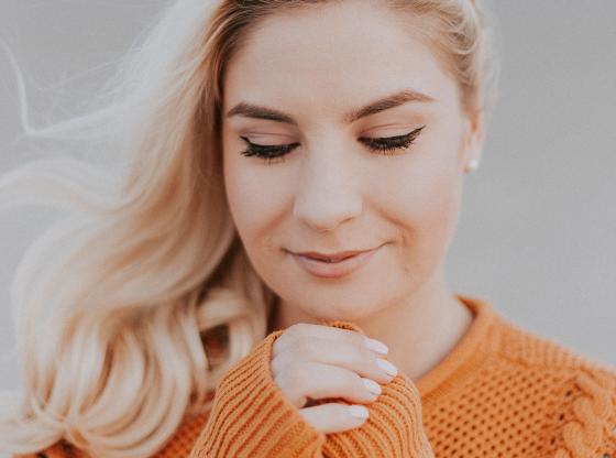 content girl in orange sweater