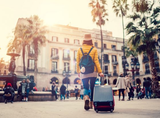 woman with suitcase in Spain