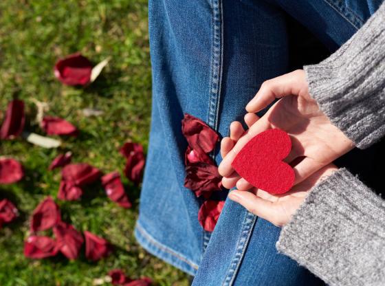 hands holding felt heart