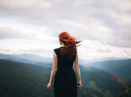 red haired woman in the wind