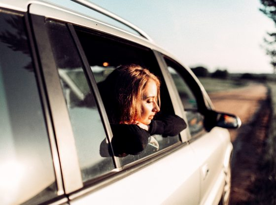 girl looking out car window
