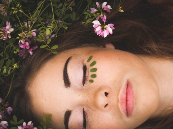woman laying in flowers