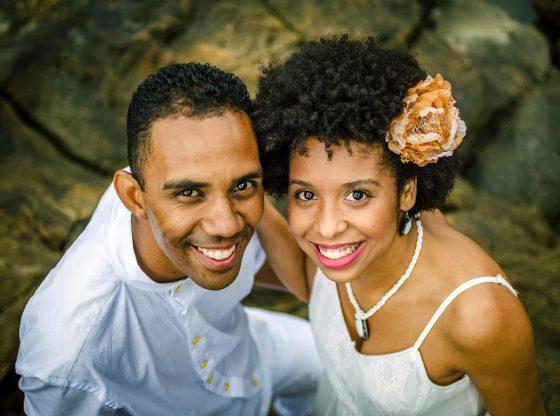 happy couple smiles up towards camera