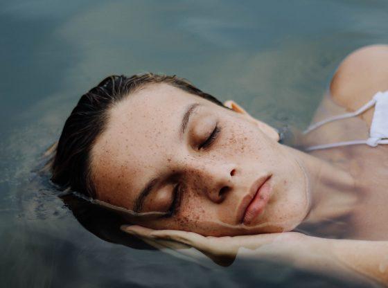 peaceful woman laying in water