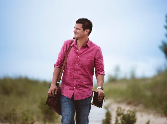 man carrying bag walking