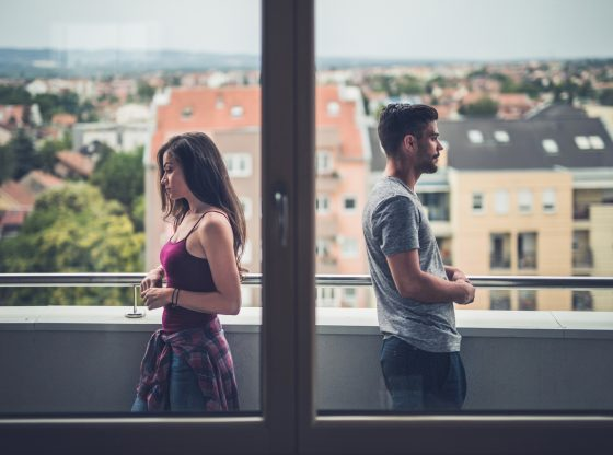sad couple standing back to back