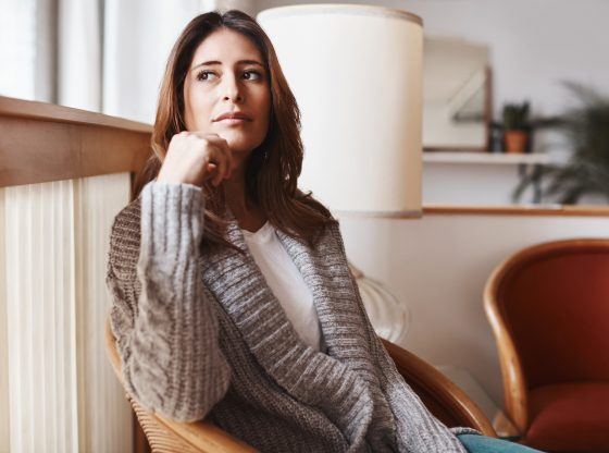 woman relaxed on chair looking away