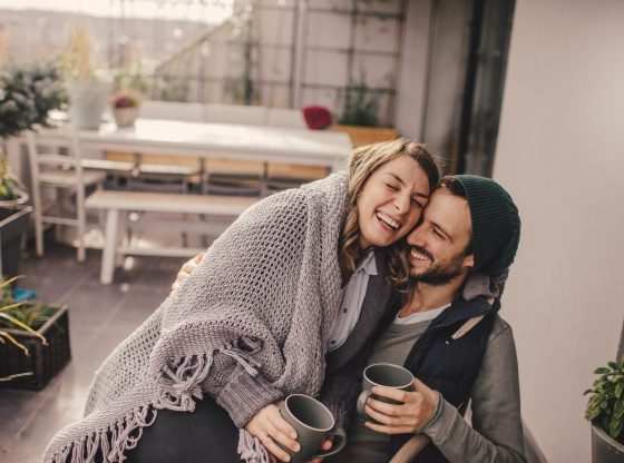 cozy couple sitting with coffee