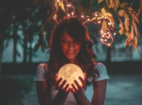 girl holding moon lamp