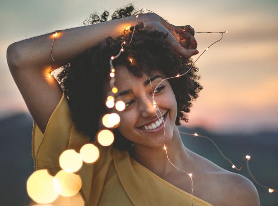 happy woman holding lights