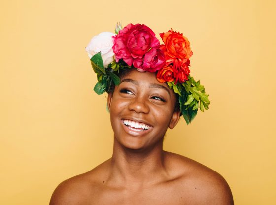 Happy African American woman wearing flower crown