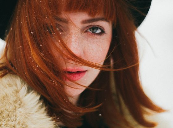 intense red headed woman in snow