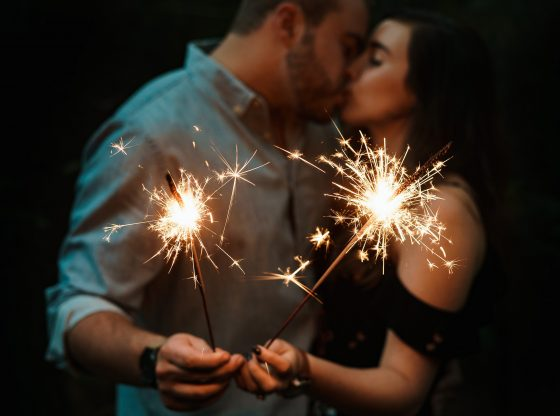 couple holding Gold Sparklers.