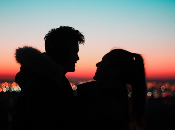 silhouette of couple at dusk