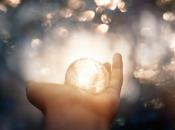 hand holding crystal ball